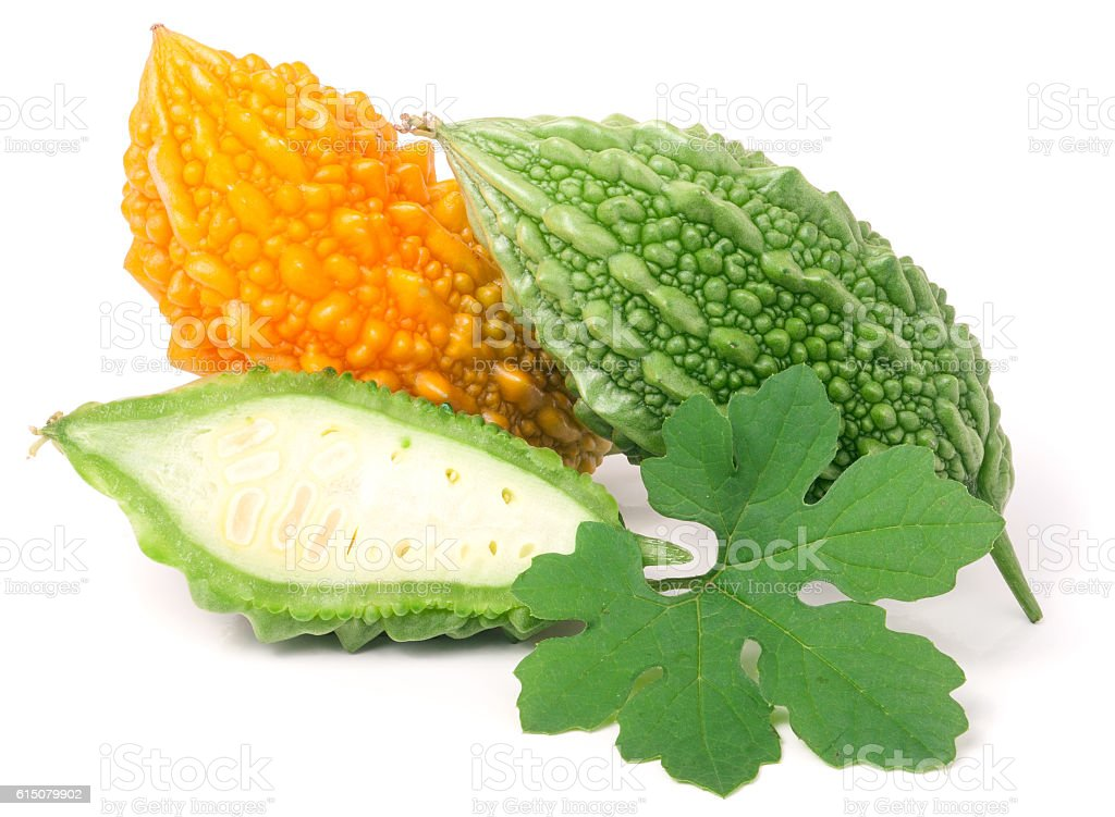 green and yellow bitter melon or momordica isolated on white stock photo