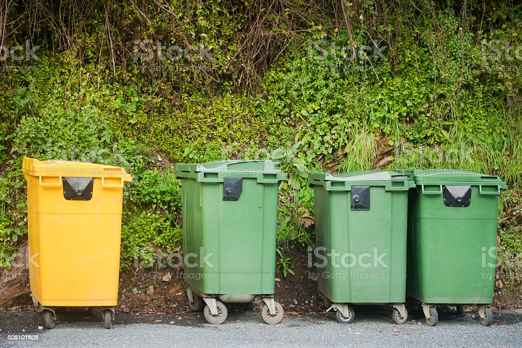 Green and yellow garbage bins for recycling. stock photo