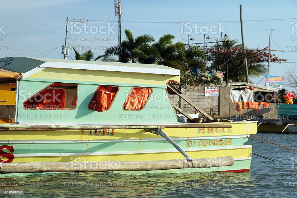 Green and Yellow Passenger Boat in the Philippines royalty-free stock photo