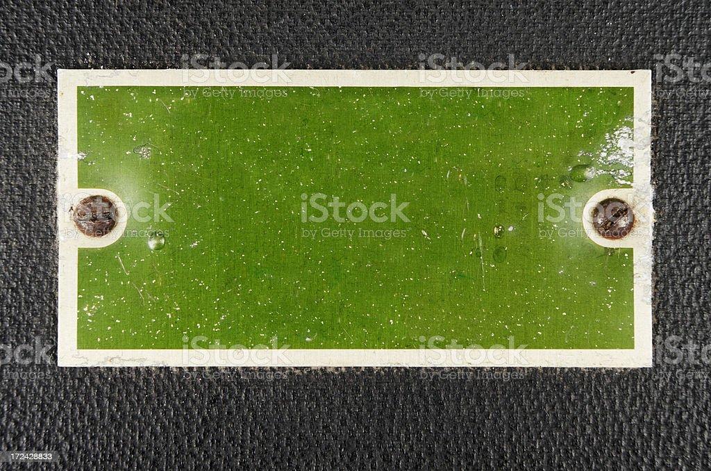 Green Anodised Aluminium Label On Leatherette Box royalty-free stock photo
