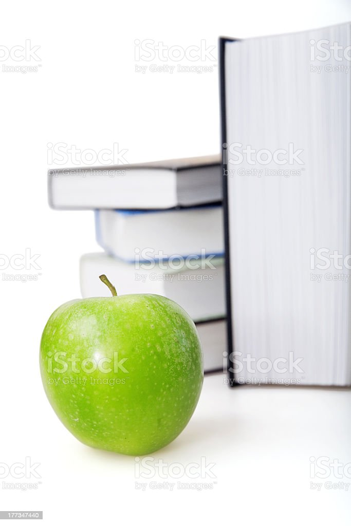 green apple and books royalty-free stock photo