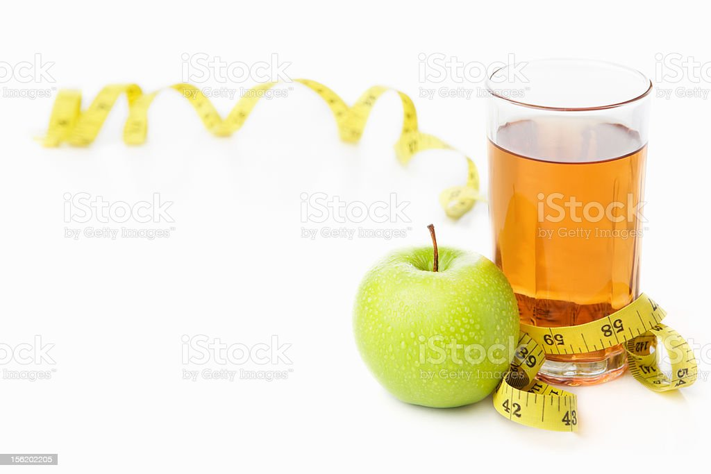 Green apple and juice with measuring tape royalty-free stock photo
