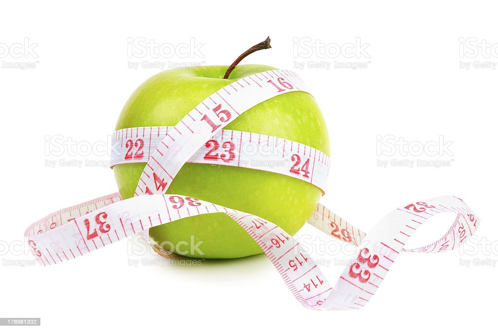 green apple and measure tape stock photo