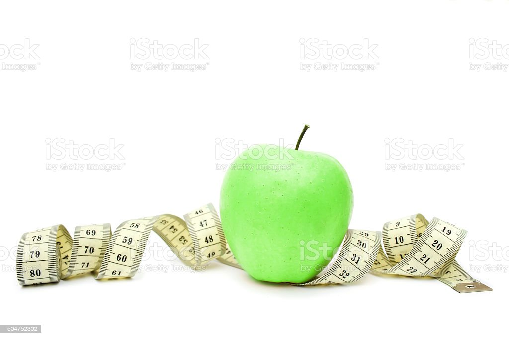 Green apple and measuring tape isolated on white background stock photo