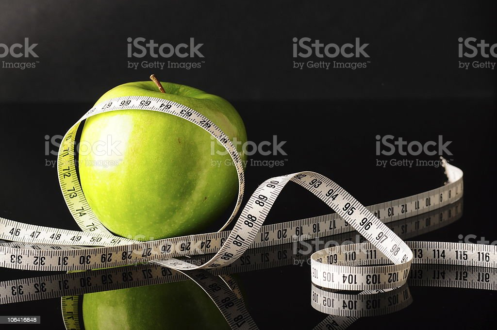 green apple and white tapeline royalty-free stock photo