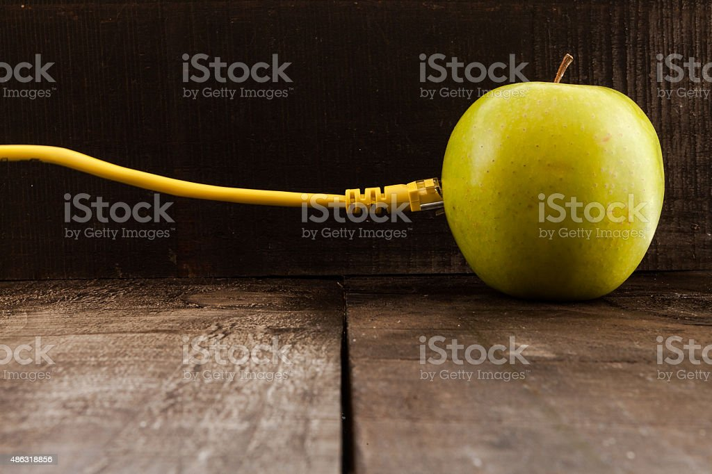 Green apple connected to a data network stock photo