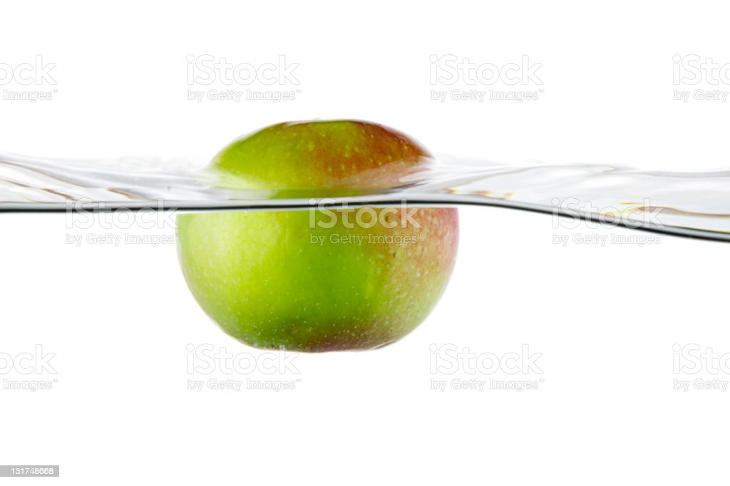 Green Apple Floating in Water royalty-free stock photo