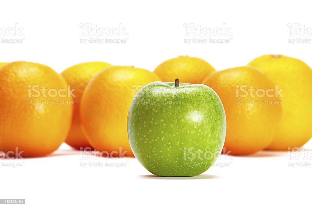 Green Apple In Front Of Oranges royalty-free stock photo