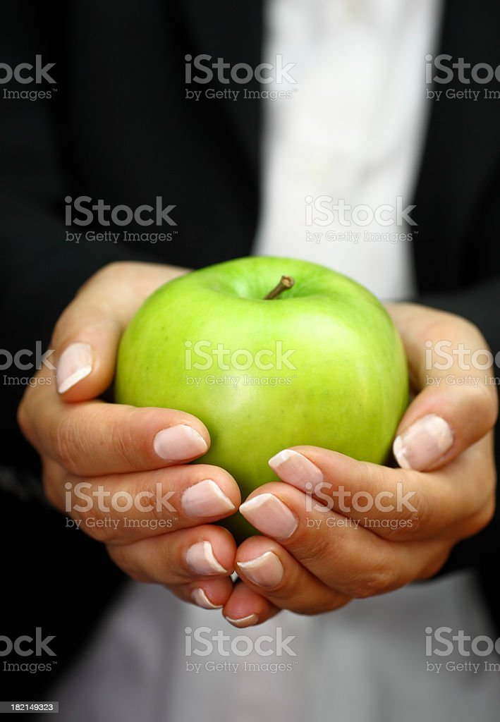 Green apple in hand royalty-free stock photo