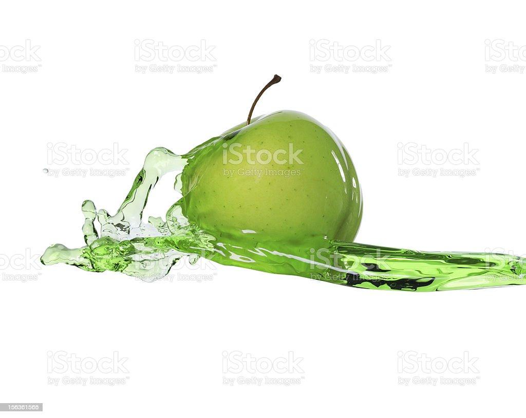 green apple in juice stream royalty-free stock photo