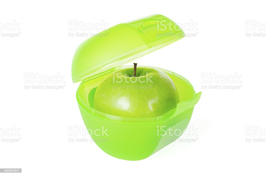 Green apple in lunch box royalty-free stock photo