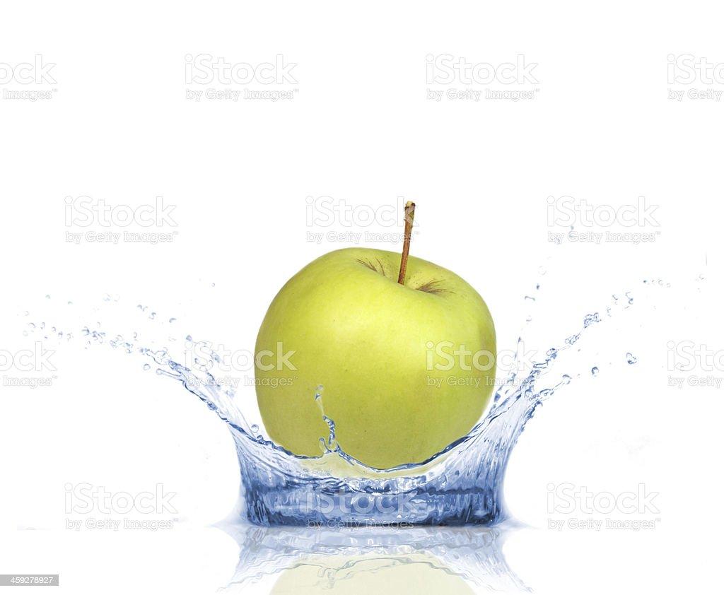 Green apple in splash royalty-free stock photo
