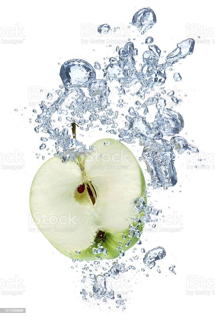Green apple in water stock photo