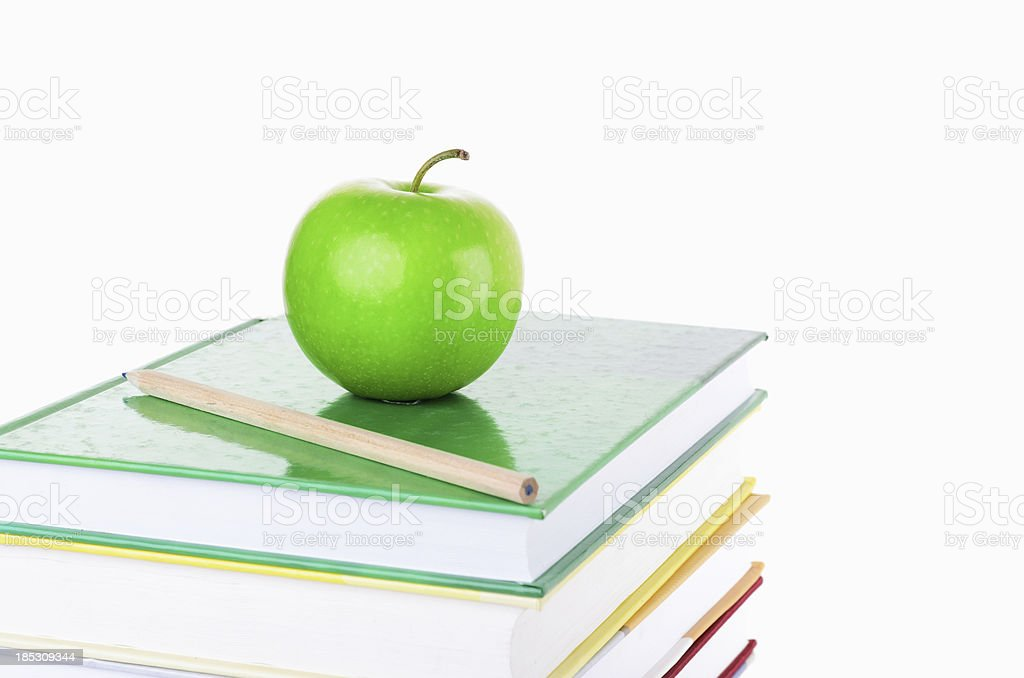 Green apple on bookes royalty-free stock photo