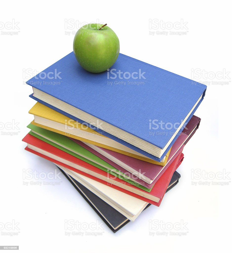 Green apple on books stock photo