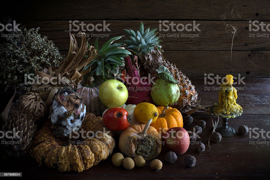 Green apple on pile rot and withered fruits stock photo