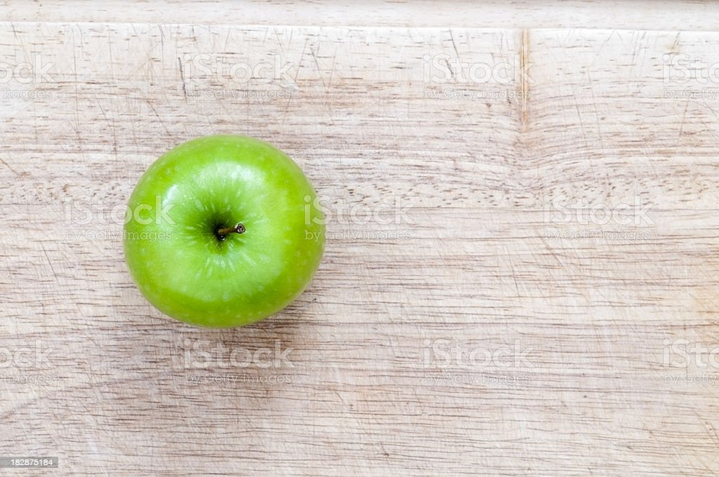 Green Apple On Table Work View from Top royalty-free stock photo