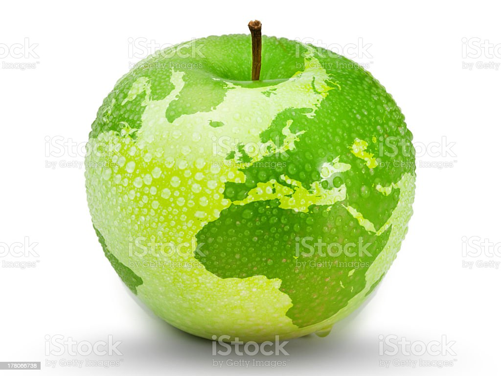 Green apple representing earth with drops on it stock photo