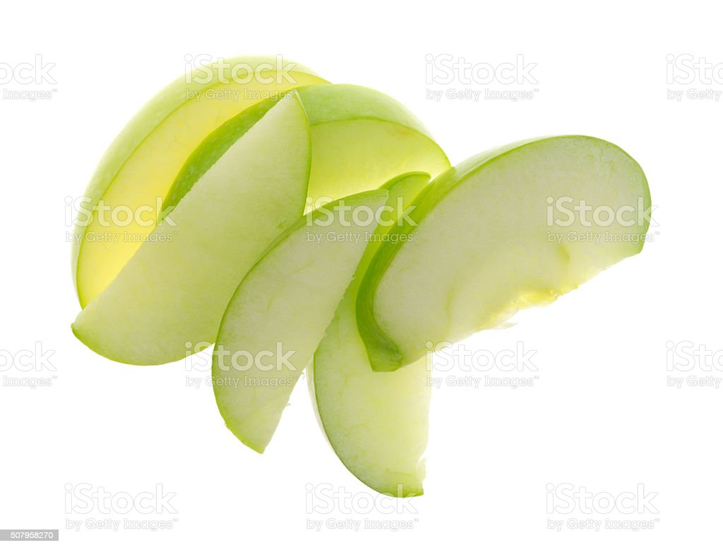 Green apple slices on white background top view stock photo