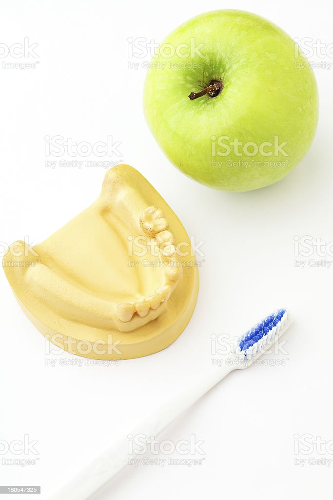 Green apple, toothbrush and denture royalty-free stock photo