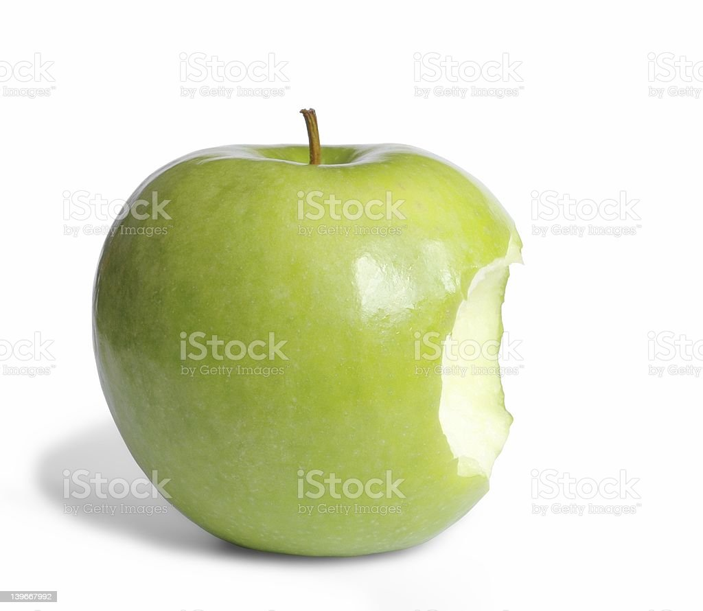 A green apple with a bite taken out of it stock photo