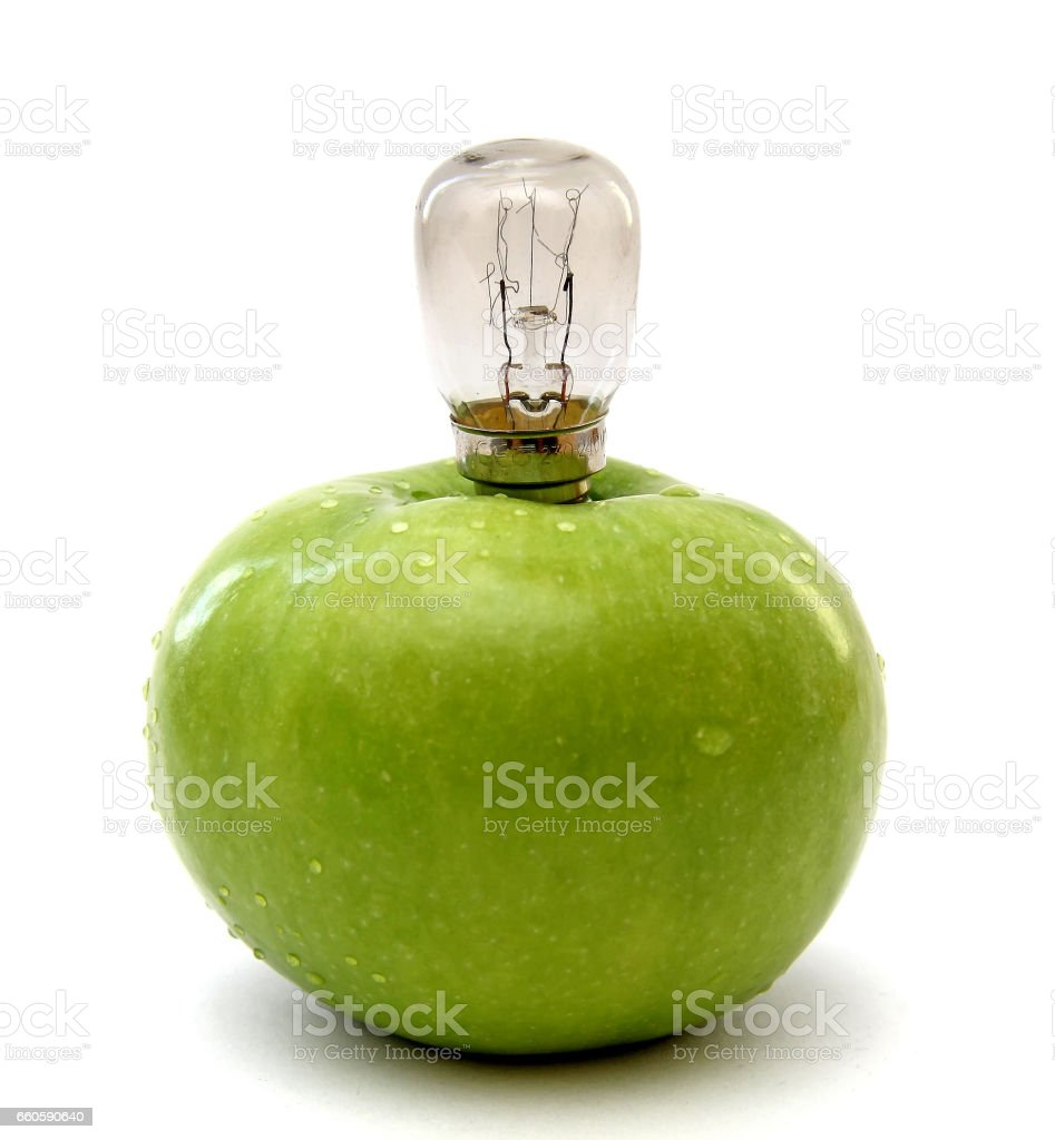 Green apple with a lamp stock photo