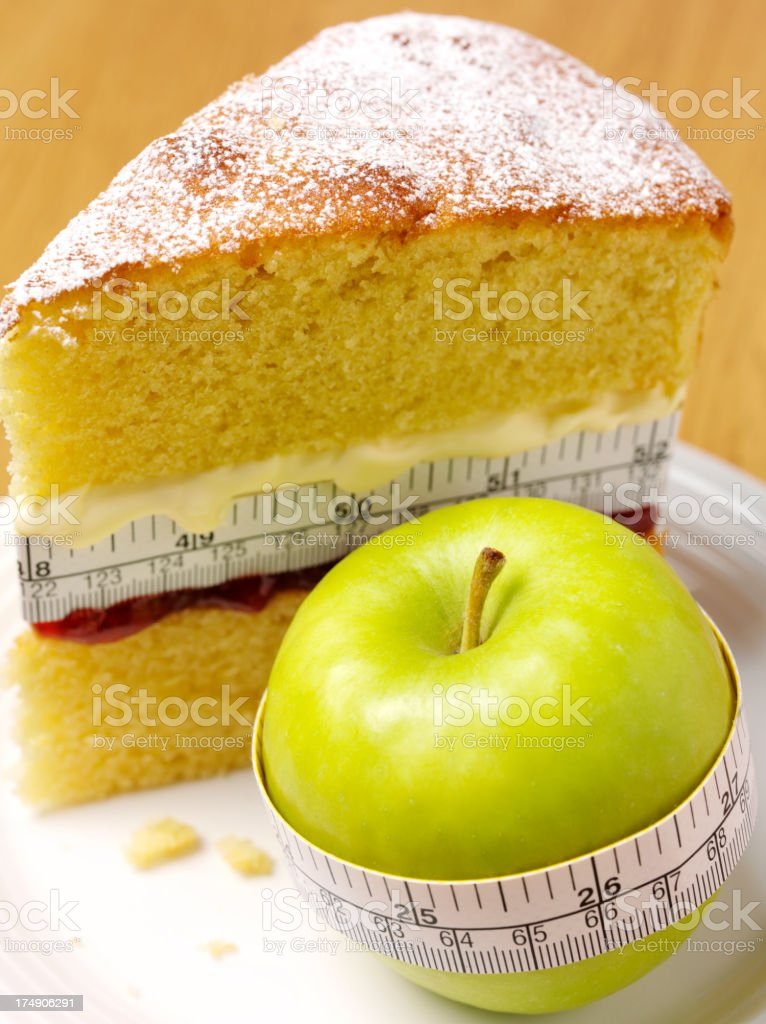 Green Apple with a Sponge Cake and Tape Measure stock photo