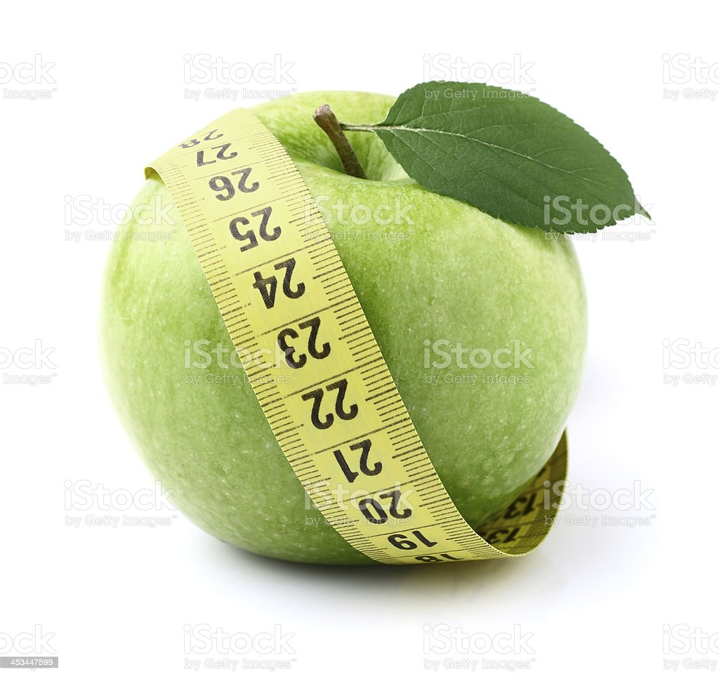 Green apple with centimeter royalty-free stock photo