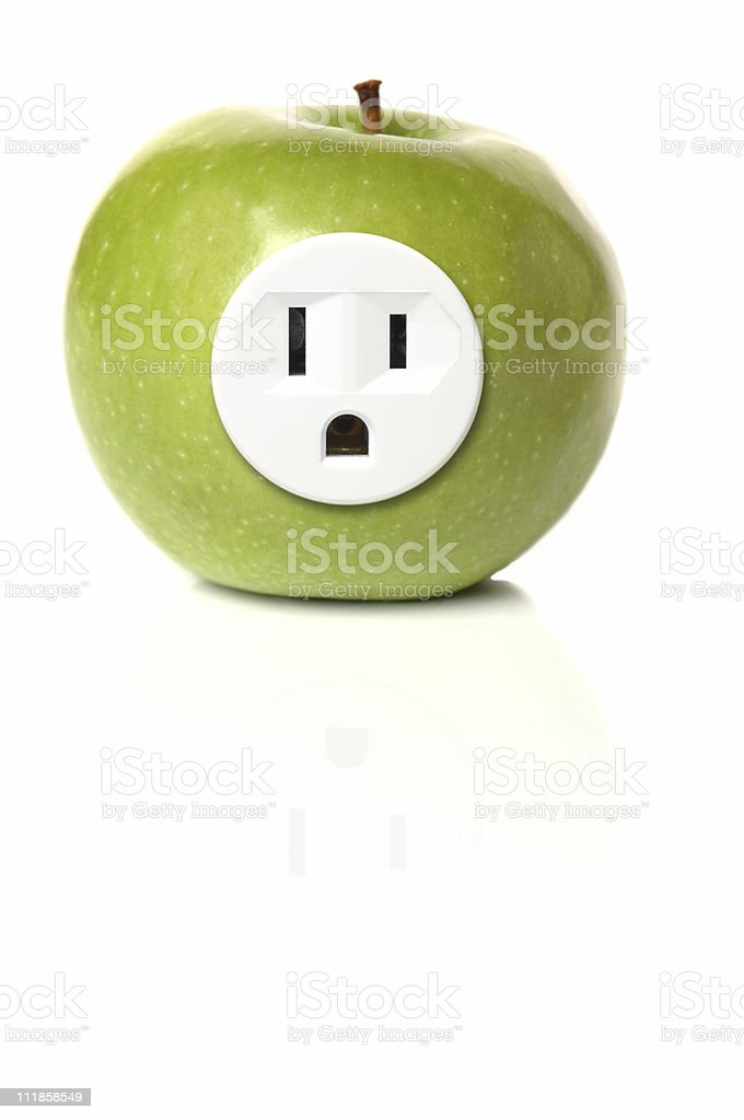 Green Apple with Electrical Outlet Isolated on White Background royalty-free stock photo