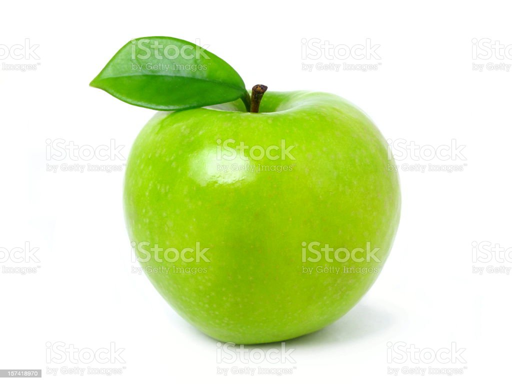 Green apple with leaf on a white backdrop royalty-free stock photo