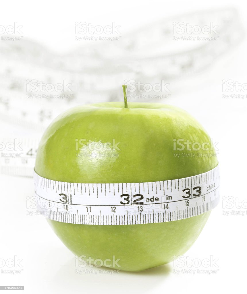 Green apple with measurement stock photo