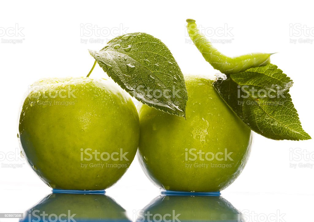 Green apple with worm royalty-free stock photo
