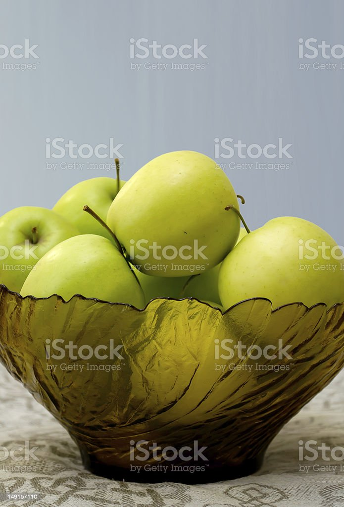 green apples in a glass vase on the table cloth royalty-free stock photo