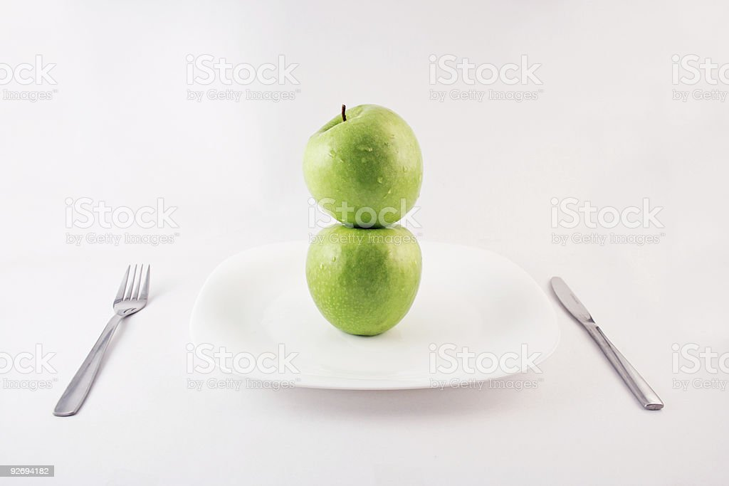 Green apples on a plate royalty-free stock photo