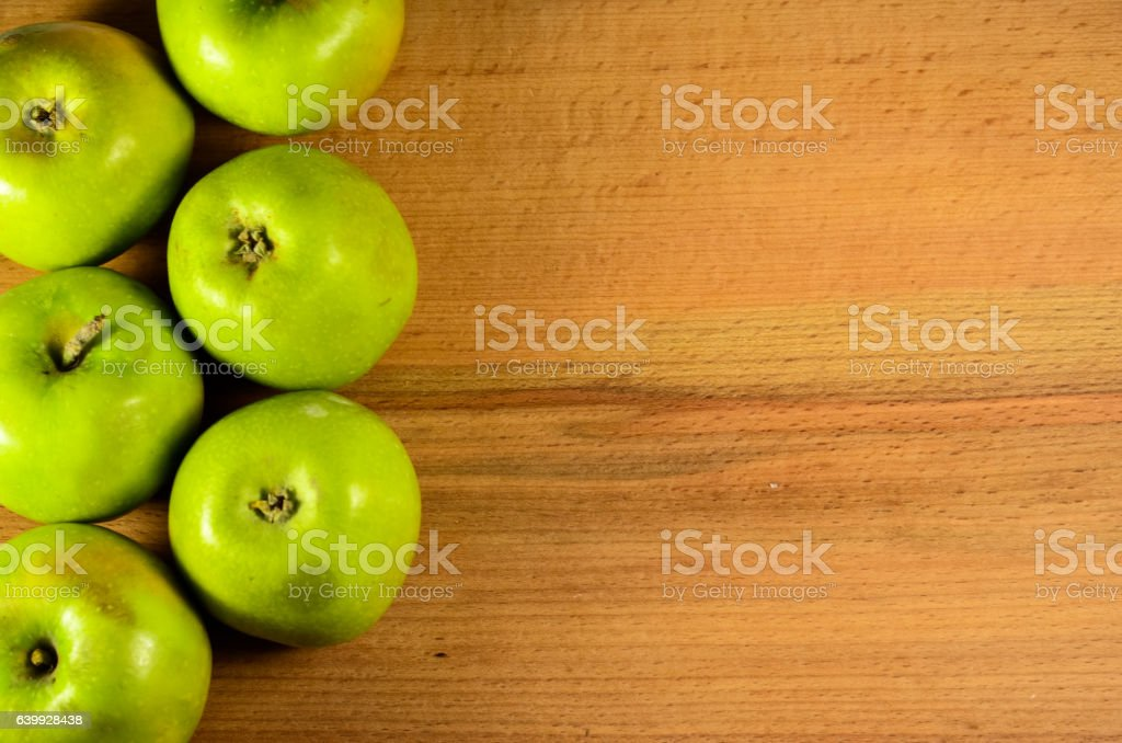 Green apples on a wooden table stock photo
