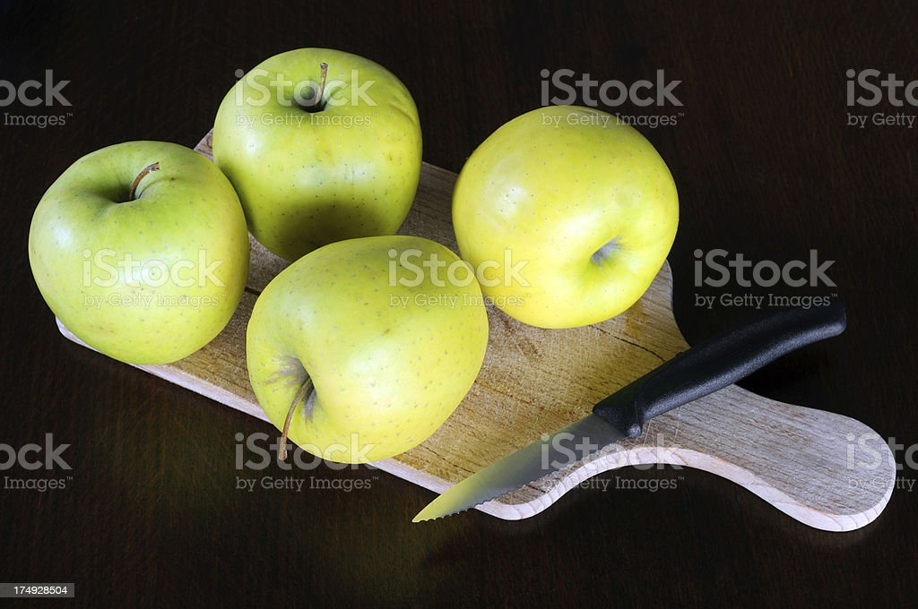 Green Apples On Cutting Board royalty-free stock photo
