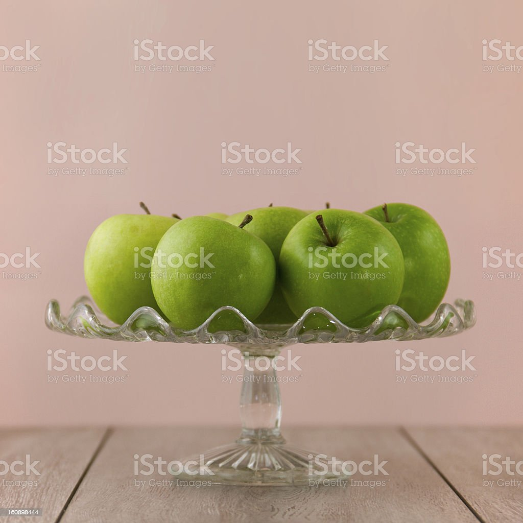Green apples on pink stock photo