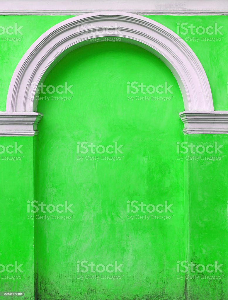 Green Architectural element an arch in the wall, Immured door stock photo