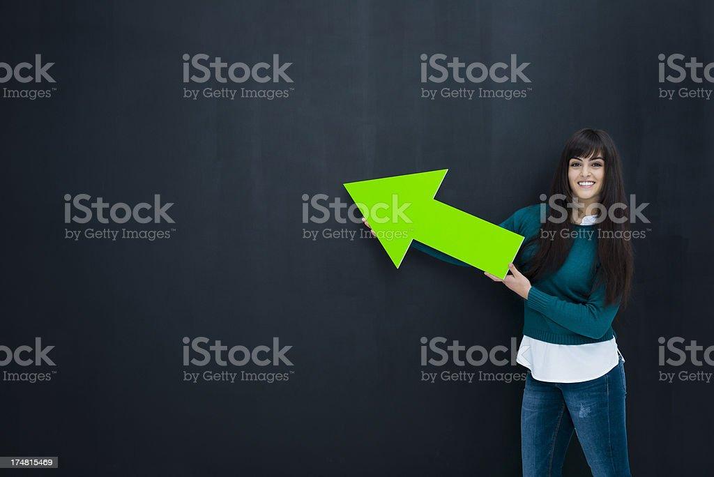Green arrow pointing to blackboard royalty-free stock photo