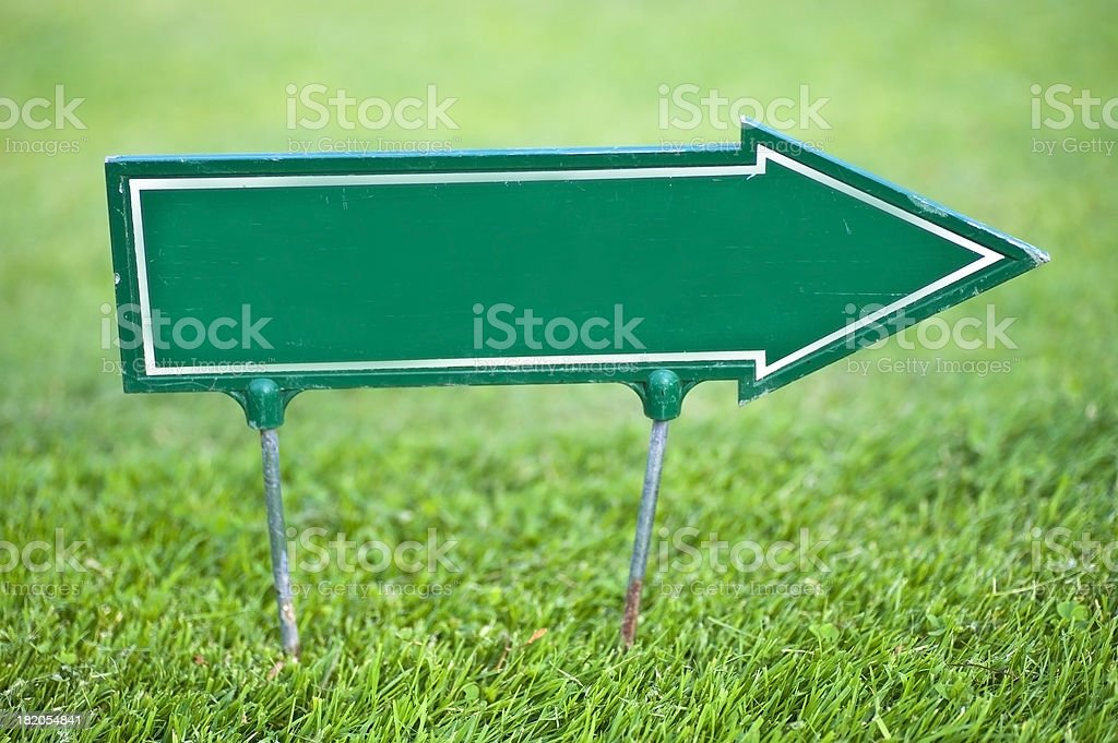 green arrow to the right site on meadow wih copyspace royalty-free stock photo