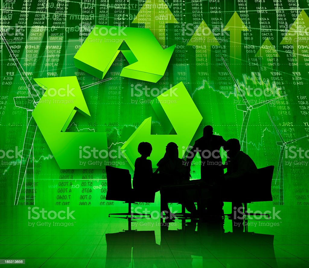 Green arrows and charts with silhouette of a group meeting stock photo