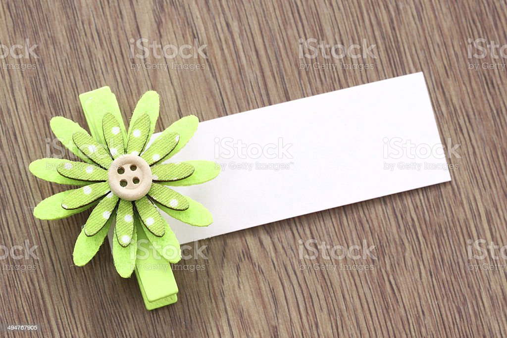 green artificial flowers and note paper stuck on dark wood. royalty-free stock photo