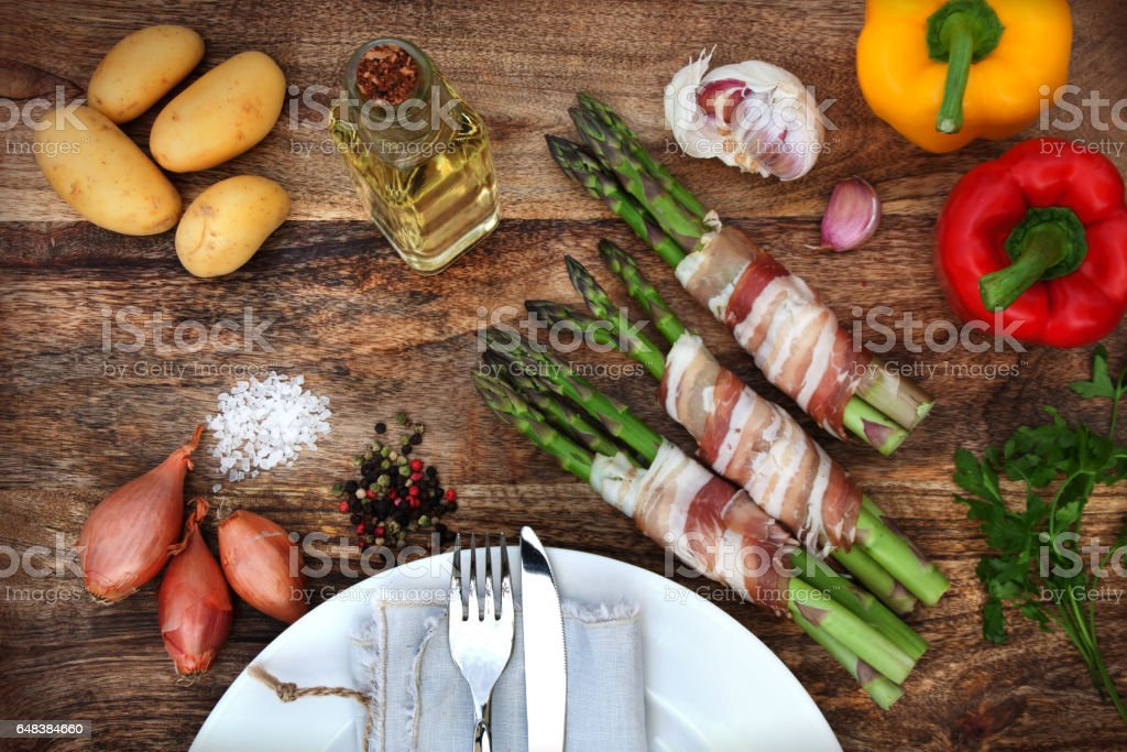 Green asparagus in bacon stock photo