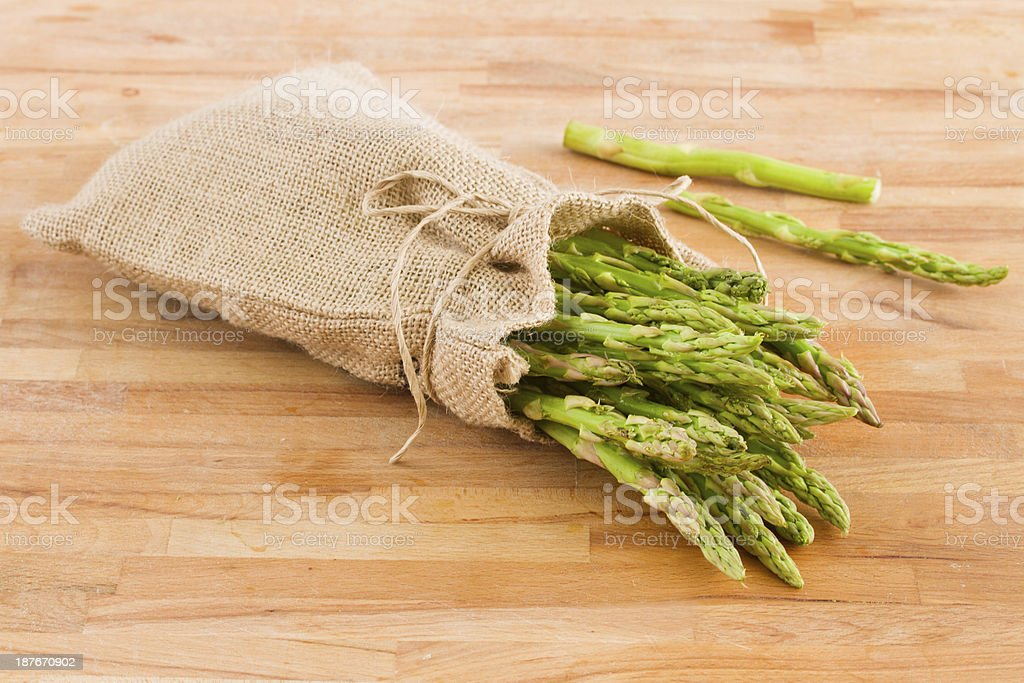 green asparagus pouch  on table royalty-free stock photo