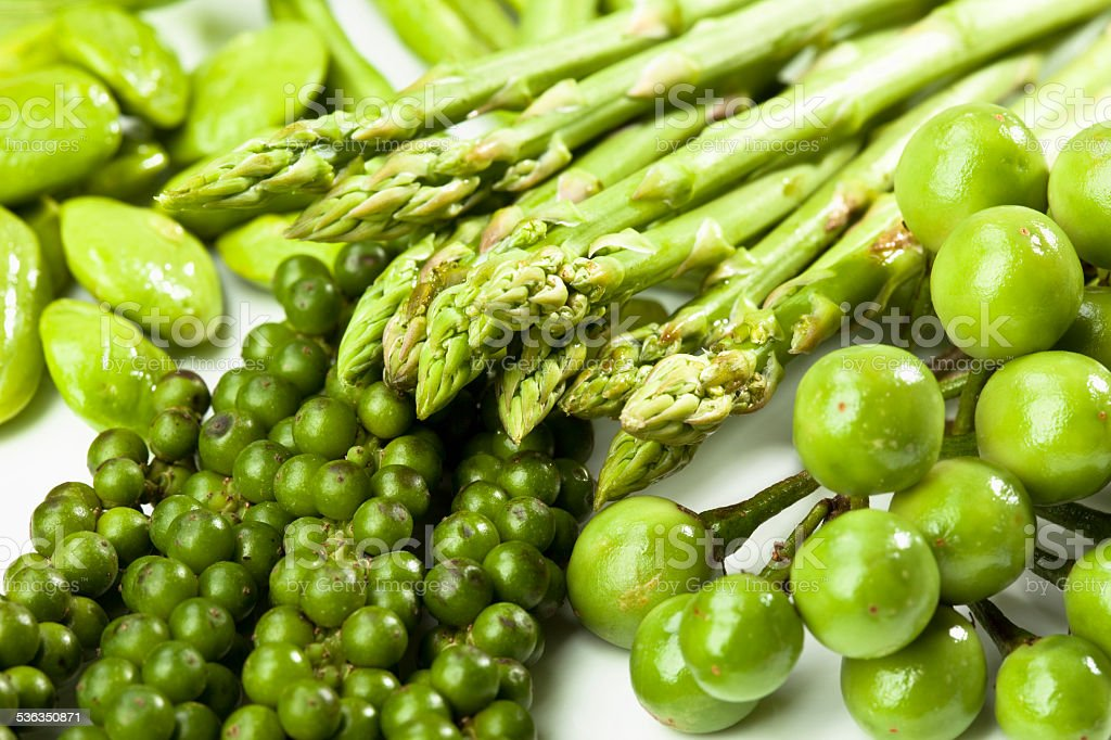 Green asparagus, Sator beans, peppercorns and eggplants, close up stock photo