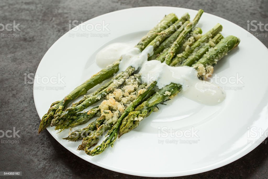 Green asparagus scalloped with parmesan cheese stock photo