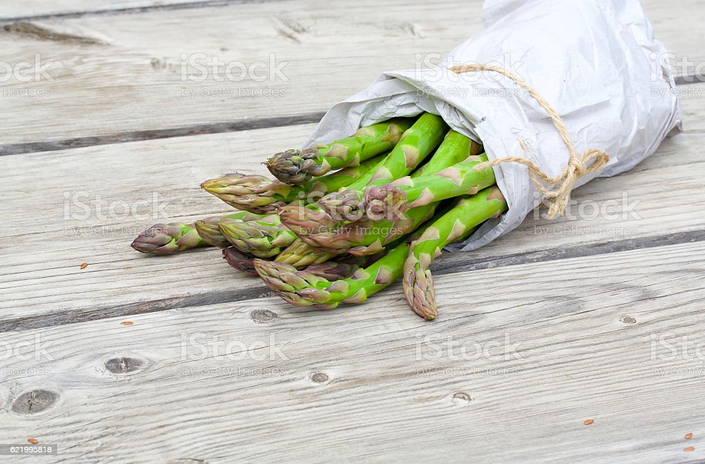 Green asparagus  wrapped in a paper stock photo