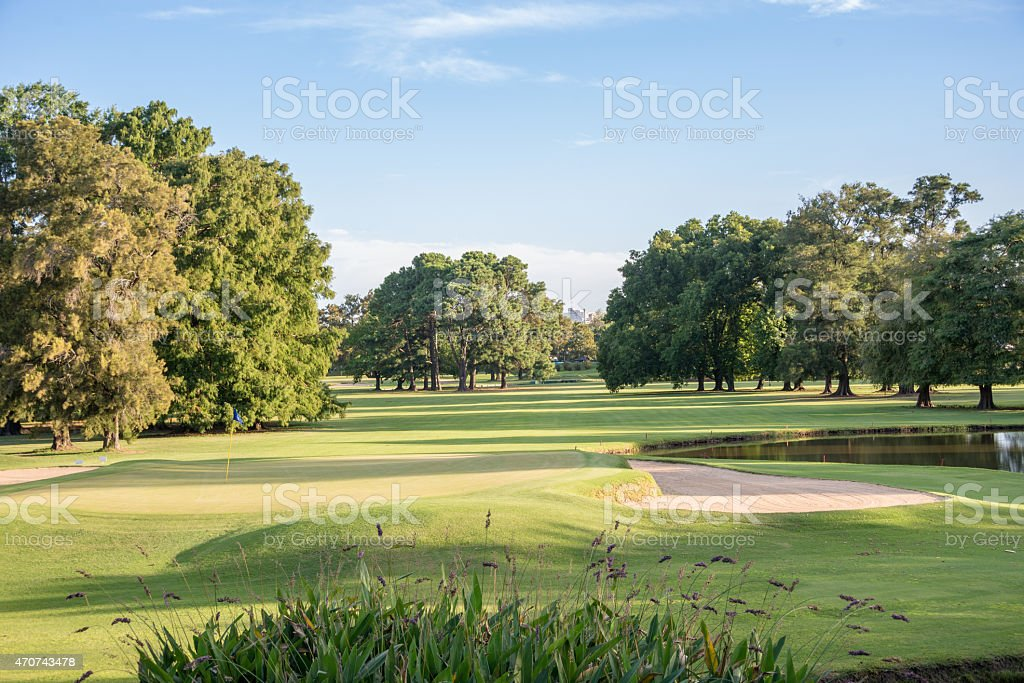 Green at sunset on a beautiful golf course. stock photo