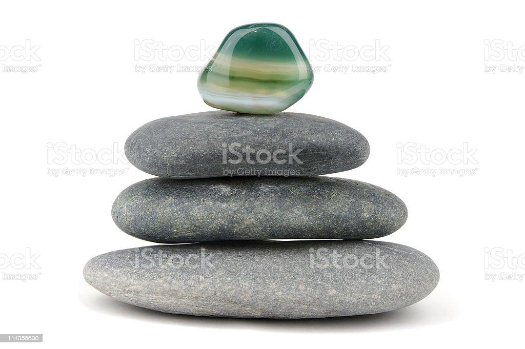 Green Aventurine Gemstone On Piled Black Stones stock photo