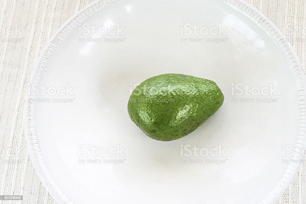 green avocado on white background royalty-free stock photo